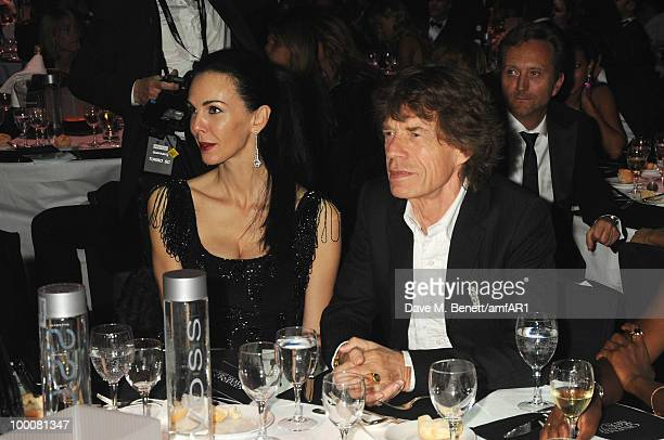 L'Wren Scott and Mick Jagger attends amfAR's Cinema Against AIDS 2010 benefit gala dinner at the Hotel du Cap on May 20 2010 in Antibes France