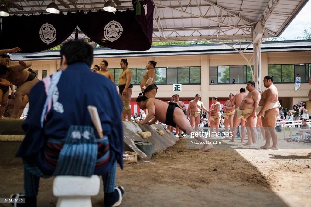 A wreslter warms up during 'Honozumo' ceremonial on April 16, 2018 in Tokyo, Japan. This annual offering of a Sumo Tournament to the divine at the Yasukuni Shrine has taken place since 1869.