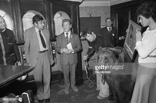 Wrestler Andy Robin with his grizzly bear Hercules at an award ceremony held by the Cartoonists' Club of Great Britain London 14th November 1980...