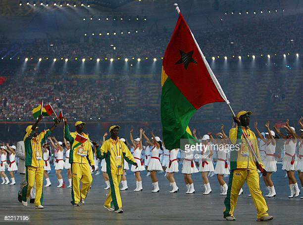 Wrestler Augusto Midana of GuineaBissau carries her country's flag during the Opening Ceremony for the 2008 Beijing Summer Olympics at the National...