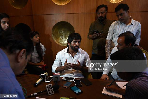 Wrestler Bajrang Puniya addresses the media during a press conference at Connaught Place on September 20 2018 in New Delhi India The wrestler briefed...