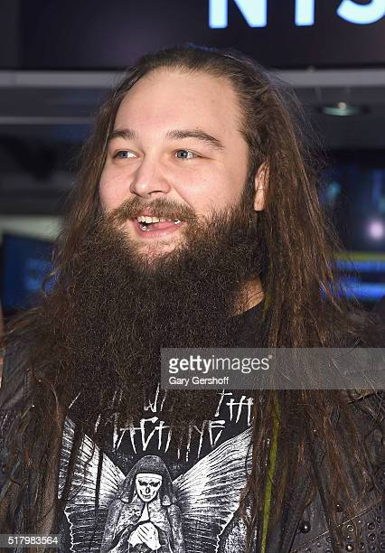 WWE wrestler Bray Wyatt poses for a picture prior to ringing the New York Stock Exchange opening bell in honor of WrestleMania 32 at New York Stock...