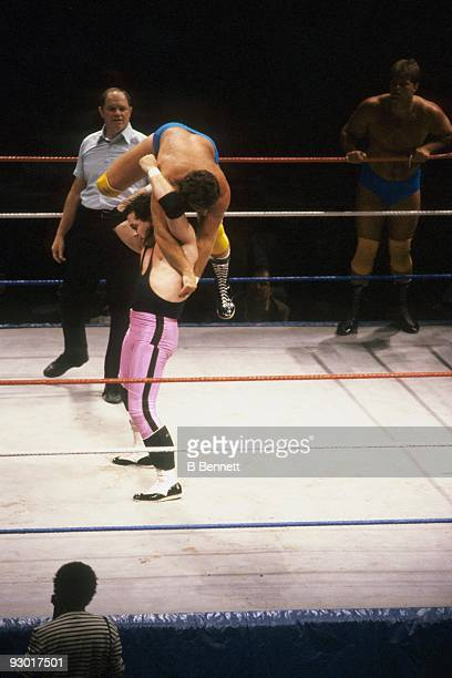 WWF Wrestler Bret 'Hit Man' Hart lifts Raymond Rougeau for a body slam during a WWF match on July 17 1987 at Nassau Coliseum in New York New York