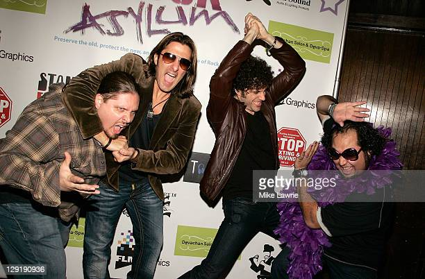 Wrestler Brimstone and Ed 'Luscious' Castillo pose with Joey Cassata and Paulie Z of ZO2 at ZO2's Rock Asylum Benefit Concert at the Hiro Ballroom at...