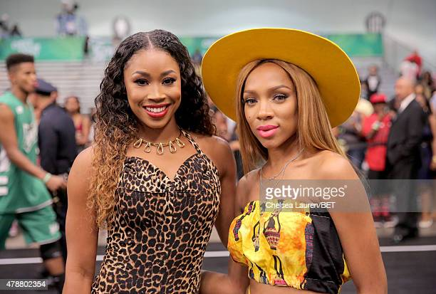 WWE wrestler Cameron and recording artist Lil' Mama participate in the Sprite celebrity basketball game during the 2015 BET Experience at the Los...
