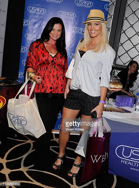 WWE wrestler Candice Michelle and actress Torrie Wilson pose with USANA during Kari Feinstein MTV Movie Awards Style Lounge at W Hollywood on June 2...