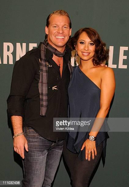 Wrestler Chris Jericho and professional dancer Cheryl Burke attend Cheryl Burke And Chris Jericho Sign Copies Of Their Books 'Dancing Lessons' And...