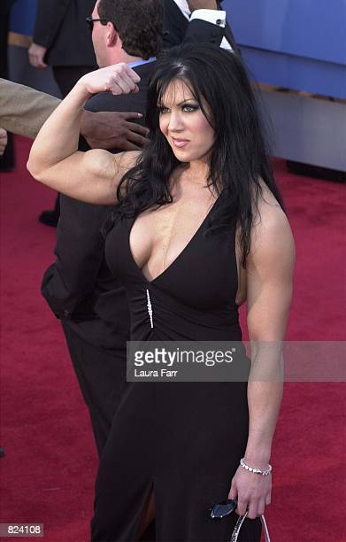 WWF wrestler Chyna flexes her muscles at the 43rd Annual Grammy Awards held at Staples Center February 21 2001 in Los Angeles CA