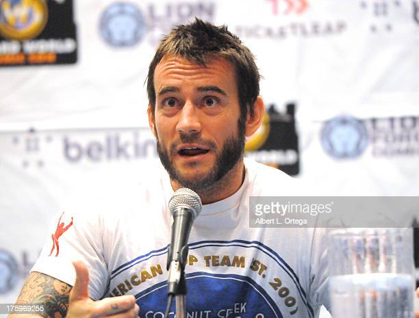 Wrestler CM Punk attends Day 2 of Wizard World Chicago Comic Con 2013 held at the Donald E Stephens Convention Center on August 10 2013 in Rosemont...