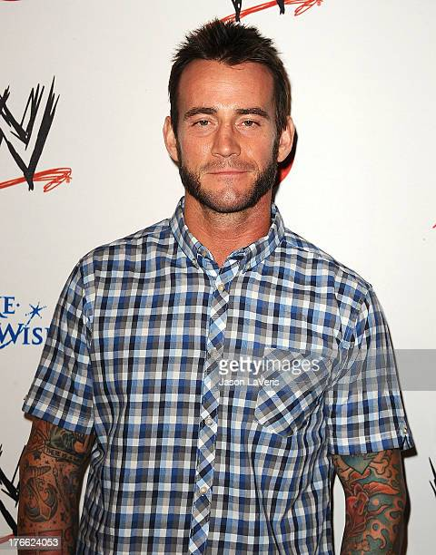 Wrestler CM Punk attends the WWE SummerSlam VIP party at Beverly Hills Hotel on August 15 2013 in Beverly Hills California