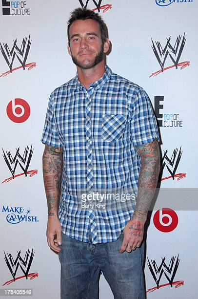 Cm punk wwe getty images wrestler cm punk attends the wwe summerslam vip party on august 15 2013 at the beverly voltagebd Image collections