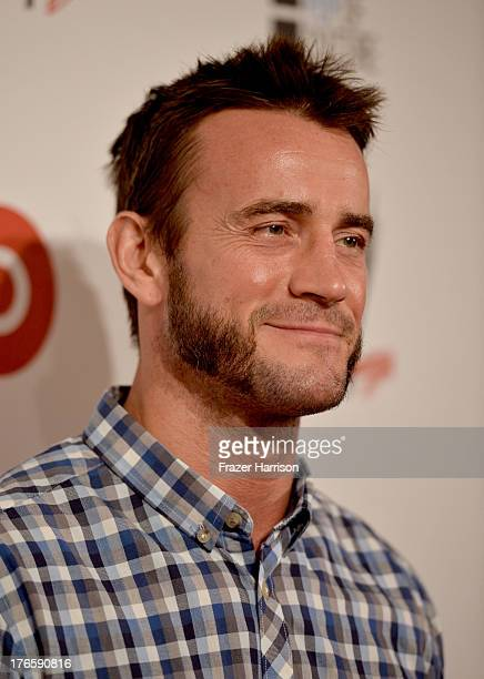 WWE wrestler CM Punk attends WWE E Entertainment's SuperStars For Hope at the Beverly Hills Hotel on August 15 2013 in Beverly Hills California