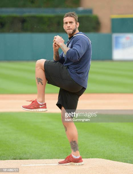 WWE wrestler CM Punk throws out the ceremonial first pitch prior to the game between the Kansas City Royals and the Detroit Tigers at Comerica Park...