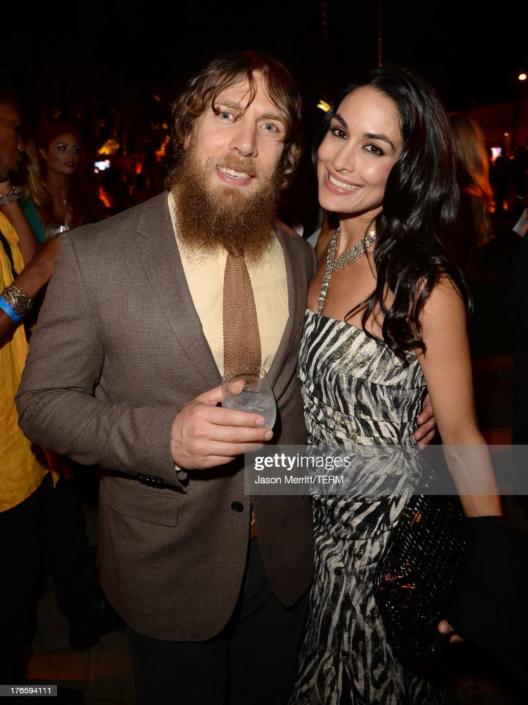 Wrestler Daniel Bryan (L) and WWE Diva Brie Bella attend WWE & E! Entertainment's 'SuperStars For Hope' at the Beverly Hills Hotel on August 15, 2013 in Beverly Hills, California.