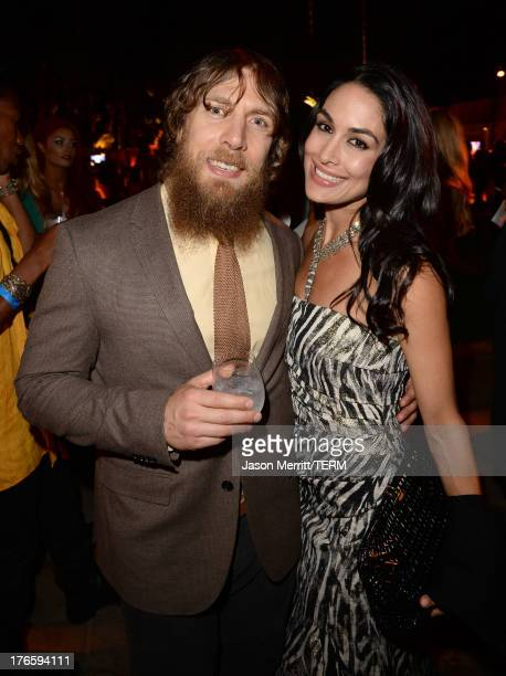 Wrestler Daniel Bryan and WWE Diva Brie Bella attend WWE E Entertainment's SuperStars For Hope at the Beverly Hills Hotel on August 15 2013 in...