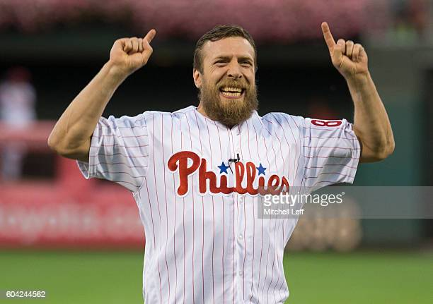 Wrestler Daniel Bryan reacts after throwing out the first pitch prior to the game between the Pittsburgh Pirates and Philadelphia Phillies at...