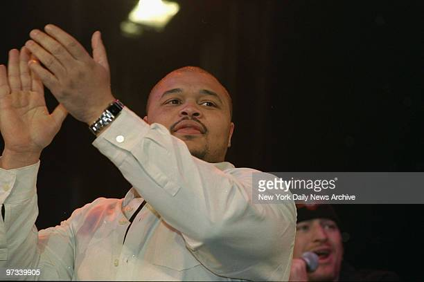 Wrestler D'Lo Brown leads the applause at the Royal Rumble party at WWF New York Restaurant. Bash was a benefit for the Police Athletic League....
