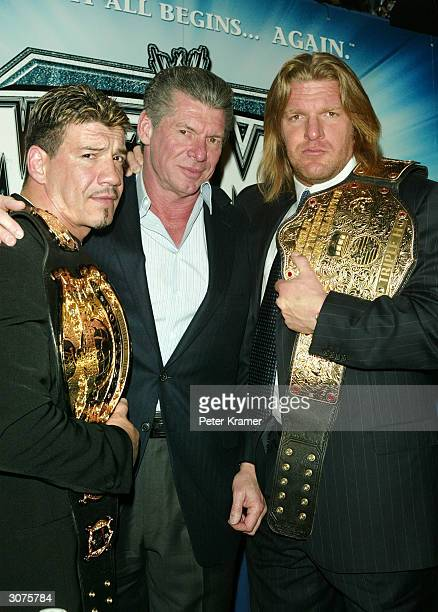 Wrestler Eddie Guerrero, WWE Chairman Vince McMahon and Wrestler Triple H attend a press conference to promote Wrestlemania XX at Planet Hollywood...