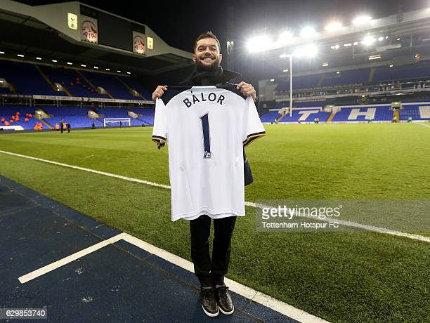 WWE wrestler Finn Balor poses for photograph with Tottenham Hotspur shirt after the Premier League match between Tottenham Hotspur and Hull City at...