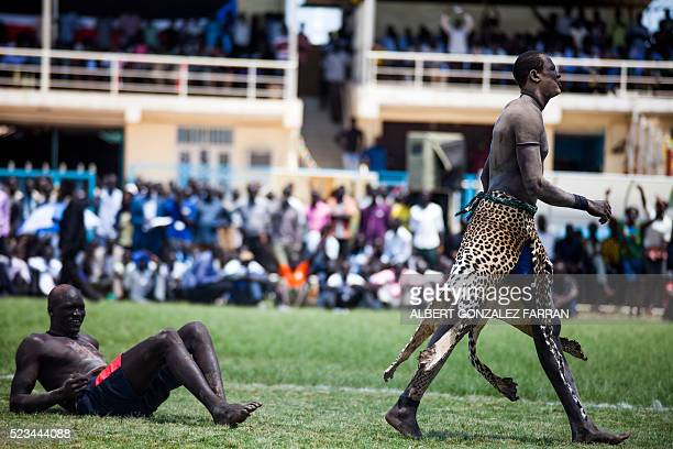 A wrestler from Jonglei leaves the ring after beating his opponent from Terekeka in the final match of the South Sudan National Wrestling Competition...