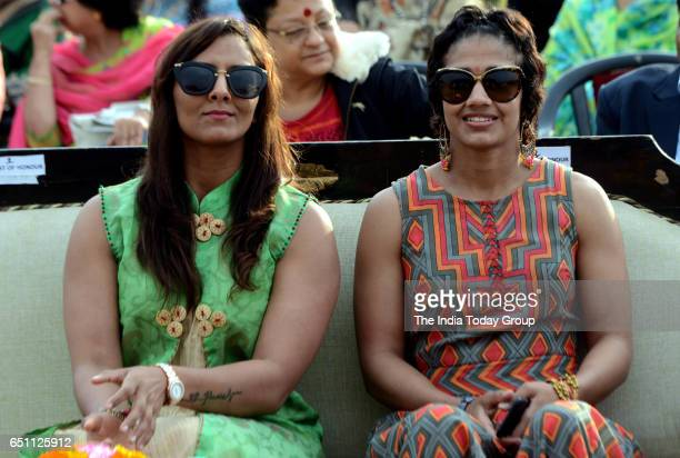 Wrestler Geeta Phogat and Babita Kumari during the celebrations of 'International Women's Day' organised by BSF at Connaught Place in New Delhi