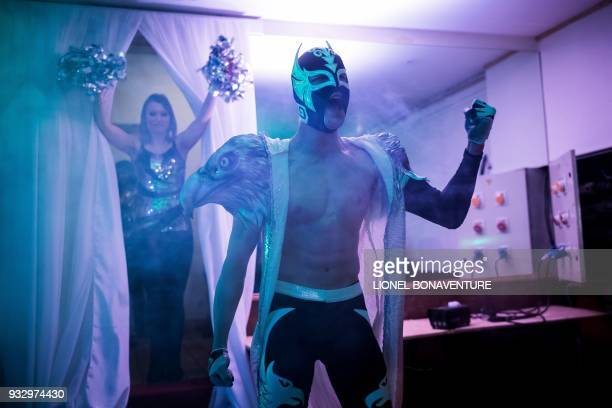 Wrestler gestures as he enters the arena for a wrestling show on March 11 in Nanterre, near Paris. - In Nanterre, the French Association of...