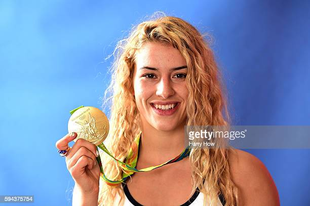 Wrestler, Helen Maroulis of the United States poses for a photo with her gold medal on the Today show set on Copacabana Beach on August 19, 2016 in...