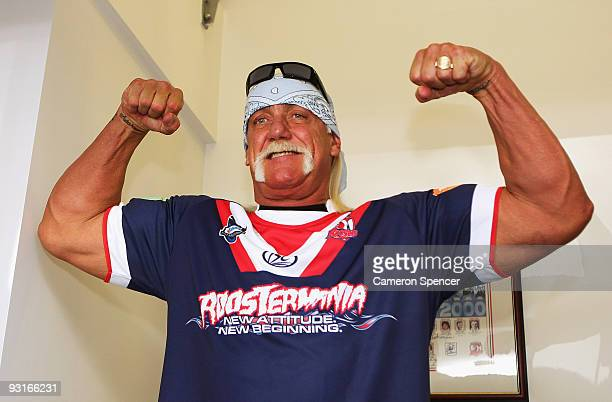 Wrestler Hulk Hogan flexes his muscles during a media opportunity with Sydney Roosters players at Roosters Headquarters on November 18 2009 in Sydney...