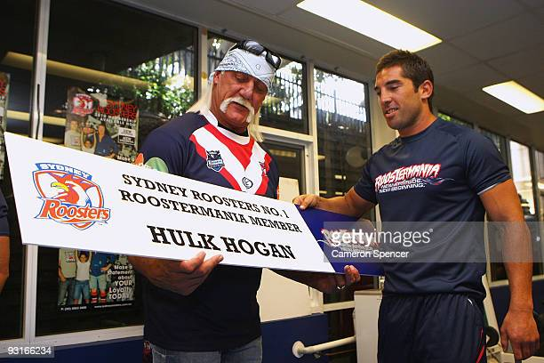Wrestler Hulk Hogan is presented with a Roostermania Member banner by Braith Anasta of the Roosters during a media opportunity with Sydney Roosters...