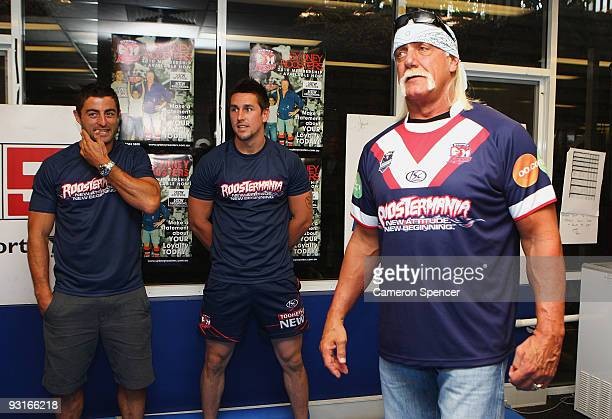 Wrestler Hulk Hogan listens to Roosters players Anthony Minichiello and Mitchell Pearce during a media opportunity with Sydney Roosters players at...