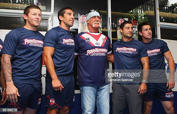 Wrestler Hulk Hogan poses with Sydney Roosters players during a media opportunity with Sydney Roosters players at Roosters Headquarters on November...