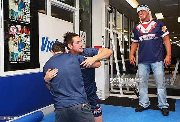Wrestler Hulk Hogan watches Roosters players Anthony Minichiello and Mitchell Pearce wrestle during a media opportunity with Sydney Roosters players...