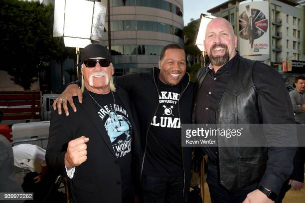 Wrestler Hulk Hogan writer Trevon Free and wrestler Paul 'Big Show' Wright II arrive at the premiere of HBO's 'Andre The Giant' at the Cinerama Dome...