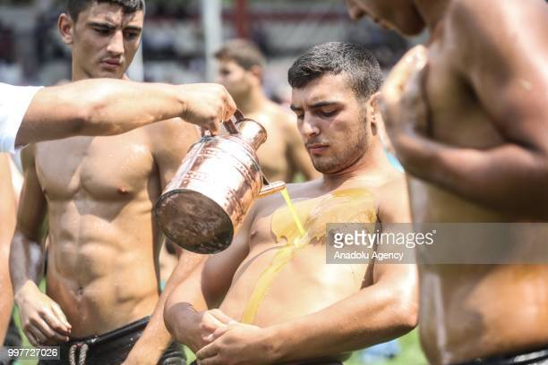 A wrestler is seen as he applies olive oil over his body before the competition during the 657th annual Kirkpinar Oil Wrestling Festival in Edirne...