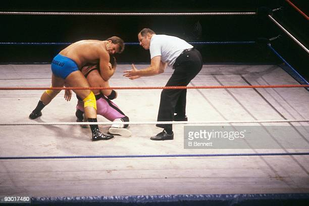 WWF Wrestler Jacques Rougeau puts a choke hold on Bret 'The Hit Man' Hart during a WWF match on July 17 1987 at Nassau Coliseum in New York New York