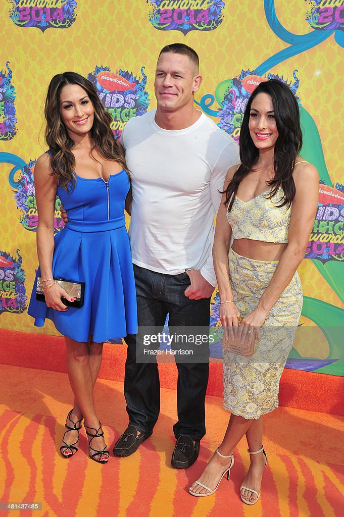 Wrestler John Cena (C) with Nikki Bella (L) and Brianna Bella (R) attend Nickelodeon's 27th Annual Kids' Choice Awards held at USC Galen Center on March 29, 2014 in Los Angeles, California.