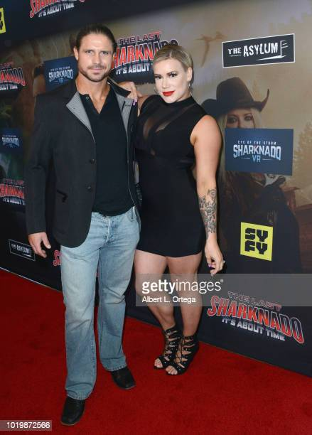 Wrestler John Hennigan and Taya Valkyrie arrives for the Premiere Of The Asylum And Syfy's 'The Last Sharknado It's About Time' held at Cinemark...