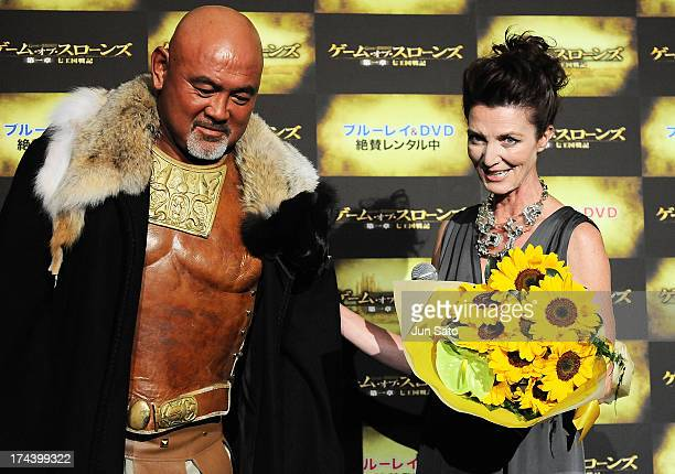 Wrestler Keiji Muto and Actress Michelle Fairley attend the 'Game of Thrones' stage greeting at Toho Cinemas Roppongi Hills on July 25, 2013 in...