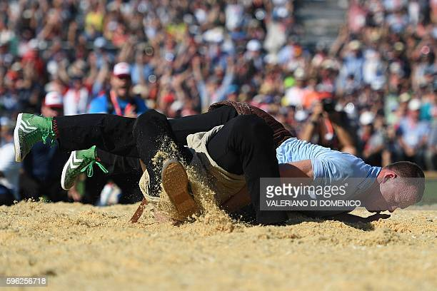 Wrestler Matthias Sempach vies with Armon Orlik during the first day of the Federal Alpine Wrestling Festival on August 27 2016 in Payerne western...