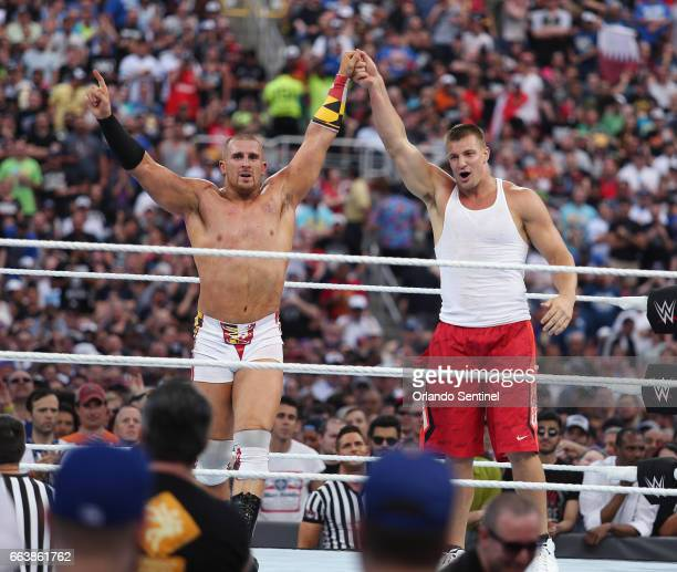 Wrestler Mojo Rawley left and New England Patriots tight end Rob Gronkowski right celebrate in the ring during WrestleMania 33 on Sunday April 2 2017...