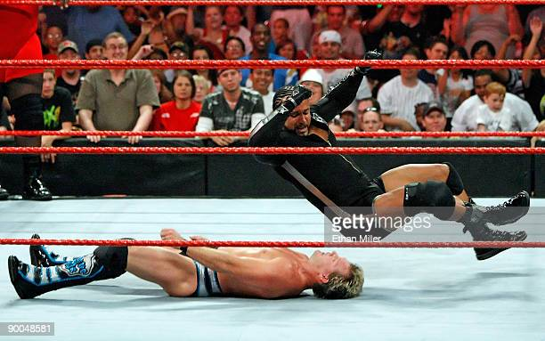 Wrestler MVP jumps on wrestler Chris Jericho during the WWE Monday Night Raw show at the Thomas Mack Center August 24 2009 in Las Vegas Nevada