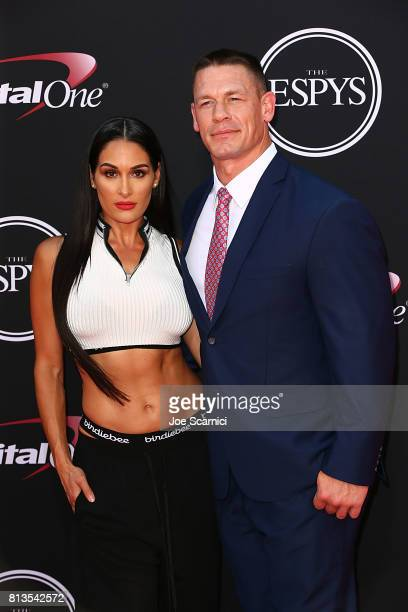 Wrestler Nikki Bella and actor/wrestler John Cena arrive at the 2017 ESPYS at Microsoft Theater on July 12 2017 in Los Angeles California