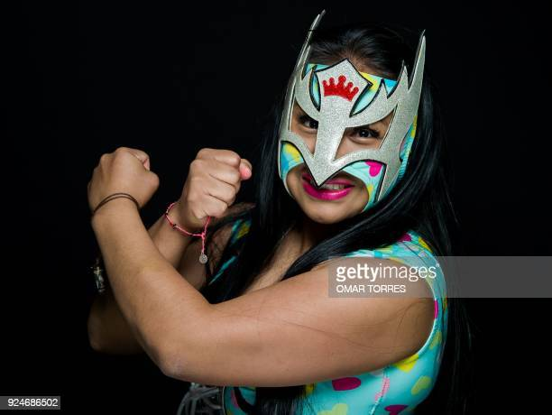 Wrestler Princess Legna, poses for pictures in Ciudad Nezahualcoyotl, Mexico State, on December 7, 2017. - Between punches and flying kicks in the...