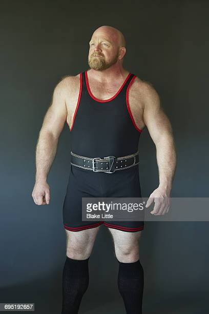 wrestler profile studio portrait - wrestling stock pictures, royalty-free photos & images