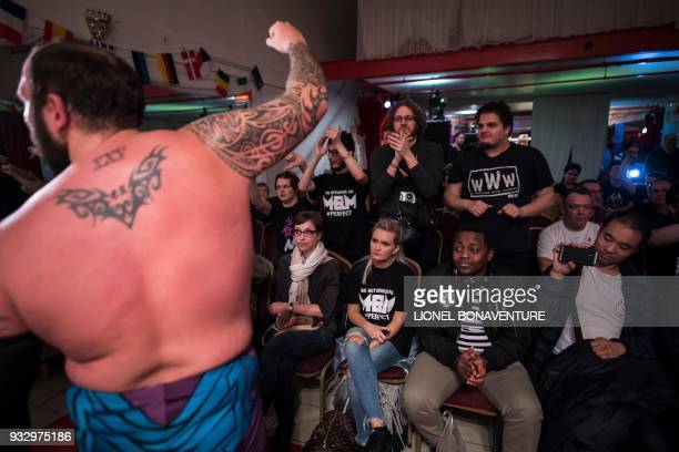 Wrestler reacts towards the audience during a show on March 11 in Nanterre, near Paris. - In Nanterre, the French Association of Professional...