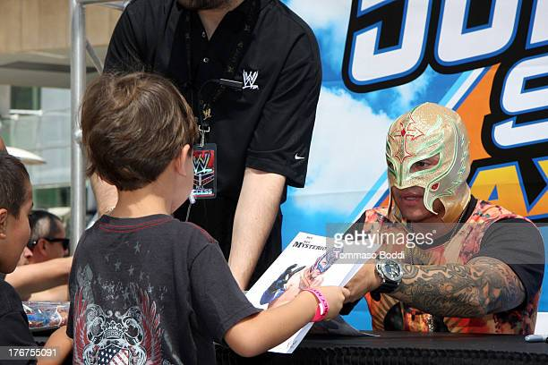 Wrestler Rey Mysterio attends the WWE and E's Total Divas takeover of SummerSlam held at Nokia Plaza LA LIVE on August 18 2013 in Los Angeles...
