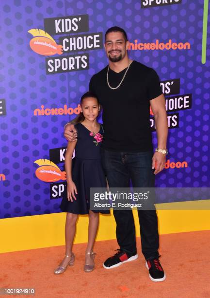 Wrestler Roman Reigns and daughter JoJo Anoa'i attend the Nickelodeon Kids' Choice Sports 2018 at Barker Hangar on July 19 2018 in Santa Monica...