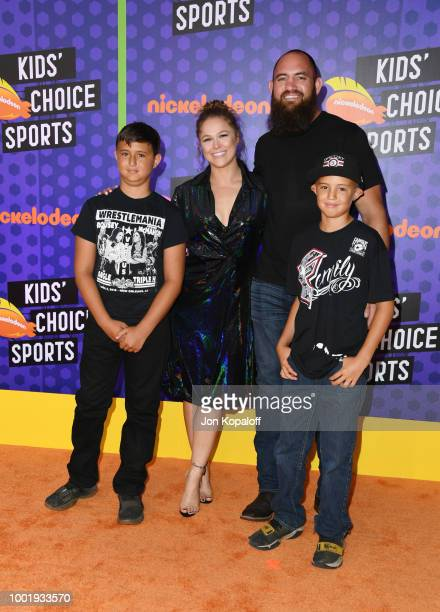 WWE wrestler Ronda Rousey and mixed martial artist Travis Browne attend the Nickelodeon Kids' Choice Sports 2018 at Barker Hangar on July 19 2018 in...