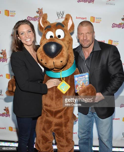 WWE wrestler Stephanie McMahon Scooby Doo and WWE wrestler Triple H pose for a picture during the 'Scooby Doo WrestleMania Mystery' New York Premiere...