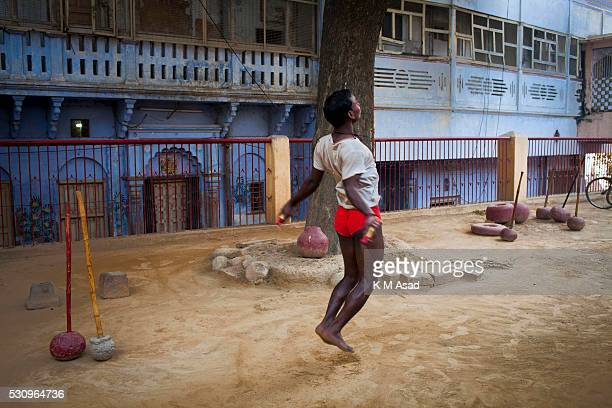 A wrestler takes daily practice in the early morning in Kashi ghat near the Gongha River in Varanasi India November 29 2014 The ancient tradition of...
